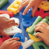 Early Childhood Education Program, children's hands playing with multicolored letters