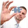 Educational Psychology, man looking at the puzzle piece between thumb and forefinger