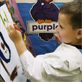 Kid making art