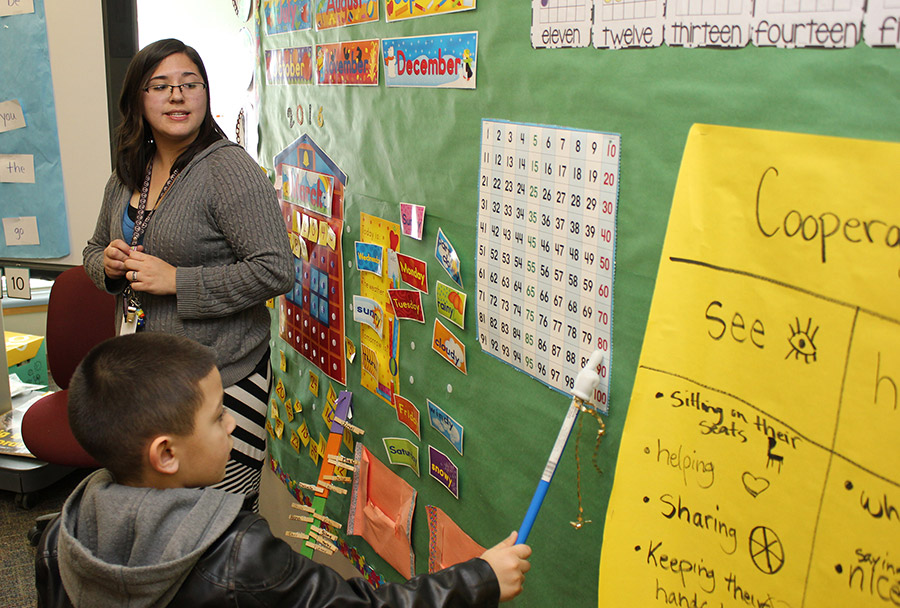 Kindergarten teacher Melissa Pease invites class participation in a counting exercise. Ms. Pease joined the staff at Pajarito Elementary School after completing her student teaching as part of the Transformational Action Group at the school.