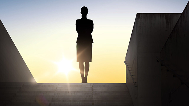 Silhouette of woman standing in stadium